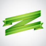 Green ribbon on gray Stock Image