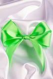 Green ribbon satin bow Stock Image