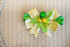 A green ribbon with small ball for decorate on rattan threshing royalty free stock photography