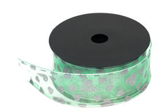 Green ribbon on spool Stock Photos
