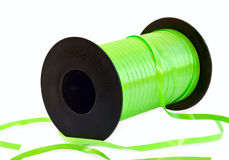 Green ribbon on spool Stock Photography