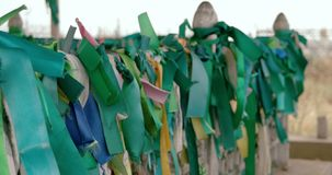 Green ribbons on a fence of ancient muslim tomb stock footage
