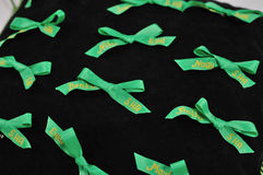 Green ribbons for graduates Stock Images