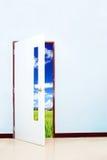 Green rice farm behind the door Stock Photo