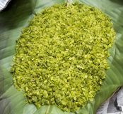 Green rice flakes  Com in Vietnamese. Com is freshly harvested sticky glutinous/sweet rice that`s been toasted to bring out i. Ts delicate flavor Stock Image