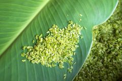 Green rice flakes ( Com in Vietnamese). Com is freshly harvested sticky (glutinous/sweet) rice that's been toasted to bring out i. Ts delicate flavor Stock Image