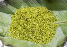 Green rice flakes  Com in Vietnamese. Com is freshly harvested sticky glutinous/sweet rice that`s been toasted to bring out i. Ts delicate flavor Royalty Free Stock Photos