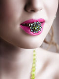 Green ring in pink lips royalty free stock images