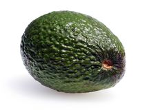 Green ripe avocado. A beautiful ripe green avocado highlighting the strong waxy skin that protects the fruit stock images