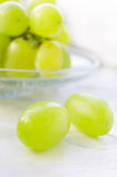 Green ripe grapes in plate Royalty Free Stock Photography