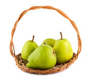 Green ripe pears in wicker basket Royalty Free Stock Image