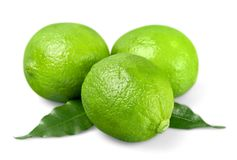 Three ripe green limes isolated on white. Green ripe three lime color group white Stock Photography