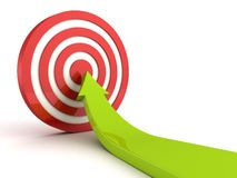 Green rising arrow pointing in center of red target Stock Image