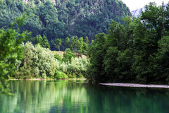 Green river in alpine austrian mountains Stock Image