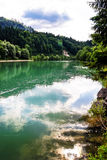 Green river in alpine austrian mountains Stock Images