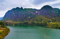 Green river blue mount in GuangXi. Karst scenery , green river blue mount in GuangXi province , china Royalty Free Stock Images