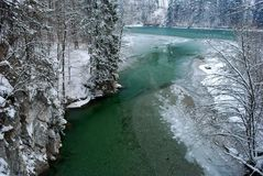 Green river with snow Royalty Free Stock Photo