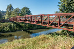 Green River Walking Bridge. A metal walking bridge spans the Green River in Washington State Stock Image