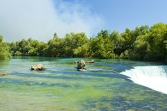 Green river and waterfall. Exotic river with waterfall in Turkey Royalty Free Stock Image