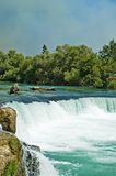 Green river and waterfall. Exotic river with waterfall in Turkey Stock Image