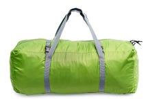 Green road bag. The full green luggage bag Stock Photos