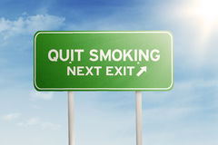 Green Road Sign With Text Of Quit Smoking Stock Images