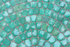 Green road tile. Background of green granite road tiles stock photo