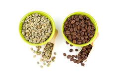 Green and roasted coffee beans Royalty Free Stock Photos
