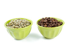 Green and roasted coffee beans Stock Images