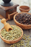 Green and roasted coffee beans Stock Photos