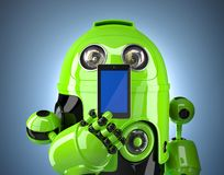 Green robot with phone. Contains clipping path of phone and entire scene Royalty Free Stock Image