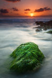 The green rock. Beautiful sunset over one of the most great shores in Israel Royalty Free Stock Image