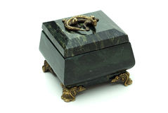 Green rock's small box. With bronze lizard Royalty Free Stock Images