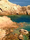 Green rocks. Some rocks formation on a Beach in Sardinia (Italy stock photography