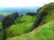 Green rocky hills of the Isle of Skye in Scotland.  Stock Images