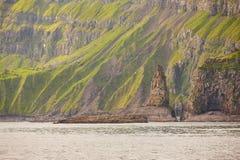 Green rocky mountain fjord landscape in Faroe islands. Vagar