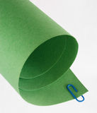 Green Rolled Paper Abstract. Green Rolled Paper and Blue Paper Clip Abstract Stock Images