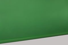 Green rolled photographic background white floor. Green rolled photographic background with white floor for montages. Vertical frame Stock Photo