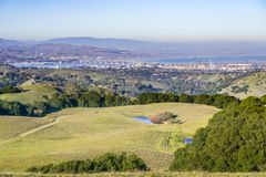 Green rolling hills in Briones Regional Park and Pollution over Suisun Bay in the background, Contra Costa county, San Francisco royalty free stock images