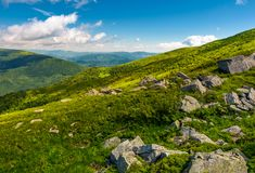 Green rolling hills of Carpathian mountains. Beautiful summer landscape under blue sky with some clouds. nice place for hike and nature connect Royalty Free Stock Images