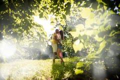 Green romance - man carrying girgfriend Stock Photos