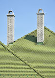 Green roof tiles and white brick smoke stacks Royalty Free Stock Images