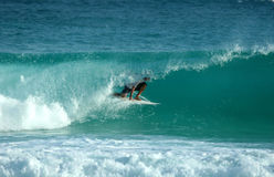 Green room. Surfer glides through a green tube Royalty Free Stock Photos