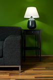Green room with sofa. And lamp Royalty Free Stock Images