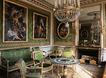 Green room with furnitures and paintings at Versailles Palace ( Chateau de Versailles ) Stock Image