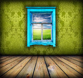 Green room with window with field and sky above it Stock Photography