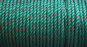 Green rope. Strong coiled rope in green and red Stock Photos