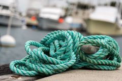 Green rope in harbor. Yachts in background of green rope in harbor Royalty Free Stock Photos