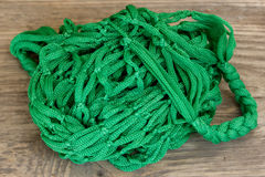 Green Rope and Textured Wood Royalty Free Stock Photos