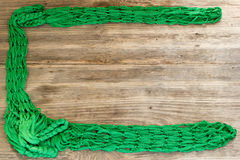 Green Rope and Textured Wood Stock Photos